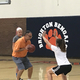 Hopkin defends Gresh as he shows his players how to shoot. (Koster Kennard/ City Journals)