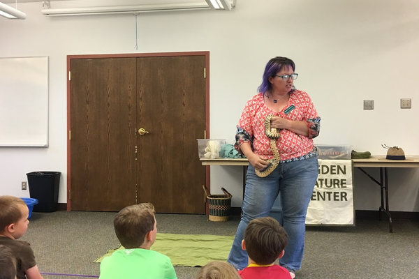 Shawnee Sawyer shows off Bert, the Great Basin gopher snake. Native to Utah, the gopher snake can grow up to seven feet long. (Kelly Cannon/City Journals)