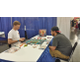 James Truitt and Jeremy Hardman play the tabletop game Yamatai. (Keyra Kristoffersen/City Journals)