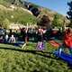 Brand new 200-hour certified yoga instructors take turns guiding Sandy residents and other attendees at Hidden Valley Park. (Keyra Kristoffersen/City Journals)