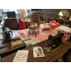 Museum display of antique sewing machines and handcrafted items. (Ruth Hendricks/City Journals)