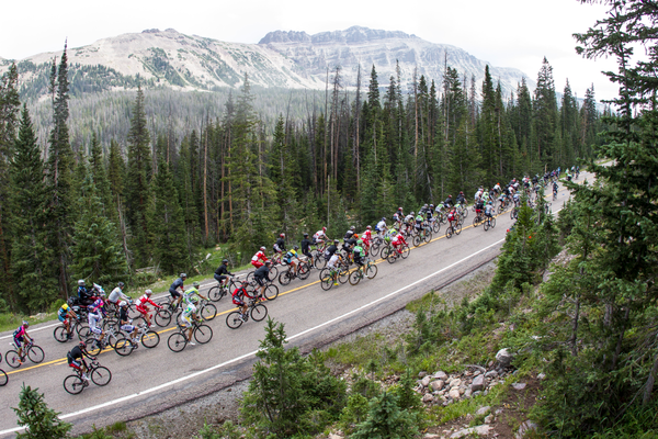 Riders from a previous tour, racing through the mountains (Jonathan Devich/Epic Images)