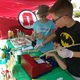 Young entrepreneurs practice social skills as well as marketing and math skills as they buy and sell products. (Jet Burnham/City Journals)