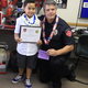 Lennox Alo with one of the firemen who helped care for his unconscious mother after he called 911 on March 18. (Mandy Ditto/City Journals)