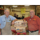 Gene Wilson (left) has been a volunteer toymaker with Alton Thacker since the beginning, in 2002. (Carl Fauver)