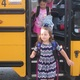 In new outfits, students met their bus drivers and headed into school.