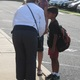 A staff member at Chadds Ford Elementary greets a mother and student on the first day.