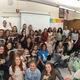 """During a teen forum on suicide prevention, Skyline High School's Community of Caring program distributed stickers that say """"stop suicide."""" (Megan Brown/Skyline High School)"""
