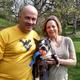 A senior dog with their adoptive parents.