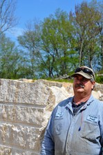 Ken Boris stands beside the creamy sandstone that went into the US Capitol Visitor Center