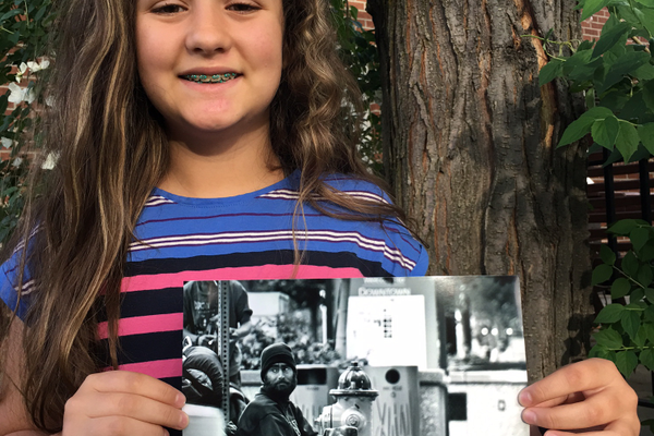 Oakdale Elementary fifth-grader Sarah Baros holds the photo that won her the Award of Merit at the national Reflections contest. (Lori Baros/Oakdale Elementary)