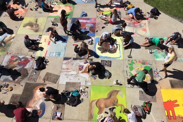 Alta High School students re-create famous works on art using sidewalk chalk.