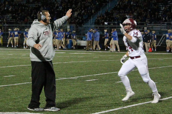 Head Coach Matt Lombardi and Liam Arbeiter high five after the Crimson defense blocked a Wayzata punt and scored.
