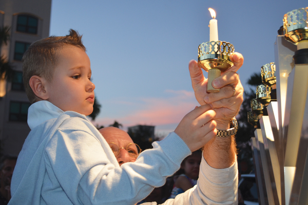 A Hanukkah celebration is held on Mercato Lawn. Photo courtesy of Jewish Federation of Collier County.