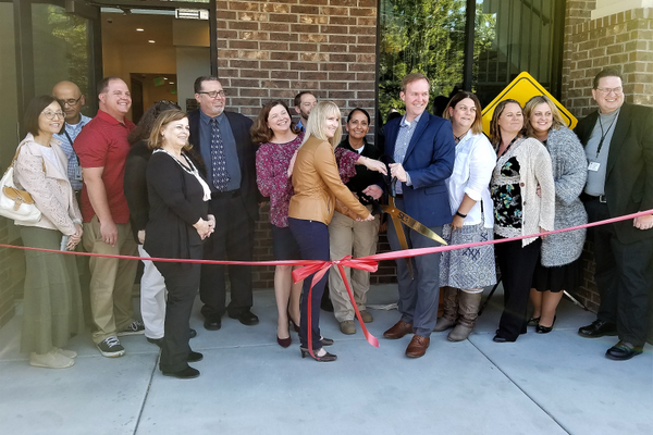 Mayor Ben McAdams with Youth Services staff and community partners celebrate at a ribbon cutting for a new youth services center. (Ruth Hendricks/City Journals)