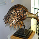 Bell's sculpture of an eagle's head took hundreds of individually sculpted feathers.