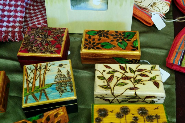 Burned wood boxes and frames by Midge Diener are displayed in the Annex.