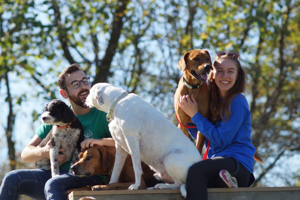 Lucky Paws' employees Brett and Caitlyn enjoying some fresh air with a few of their clients.