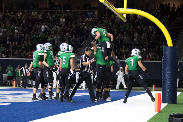 Nov. 25 - The Dragons celebrate a TJ McDaniel score during a 33-15 win over the DeSoto Eagles in the Area round of the 2017 UIL Playoffs at the Ford Center in Frisco, TX. Photo by S.Johnson/SnappedDragons.com