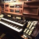 The 23-rank organ console can be played manually.