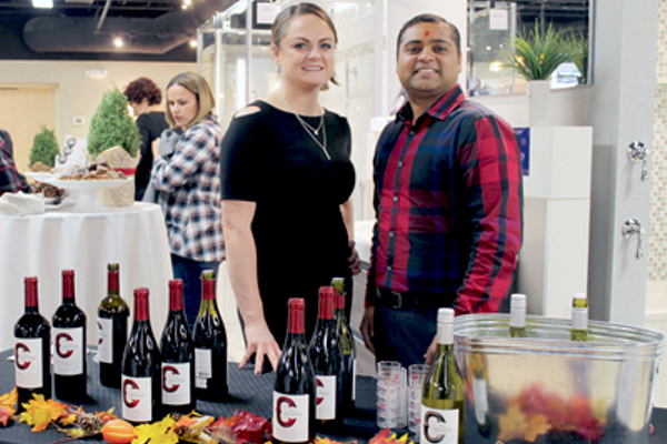 Caroline Kelley & Kenny Patel of Field's Wine & Spirits offer wine samples