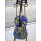 Mosaic-covered instruments by Amy Bruckner include this one, 'Forsythia Violin.'