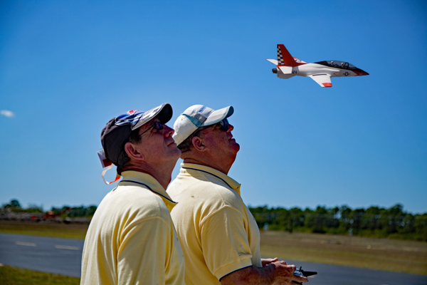 A member of the R/Sea Hawks Cape Coral Flying Club pilots a homemade replica airplane at Seahawk Park as another club member looks on. Photo courtesy R/Sea Hawks Cape Coral Flying Club.