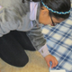 A student carefully trims the fringe on her blanket at Unionville Elementary.