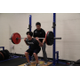 Lorne Goldenberg helps an athlete with squats.
