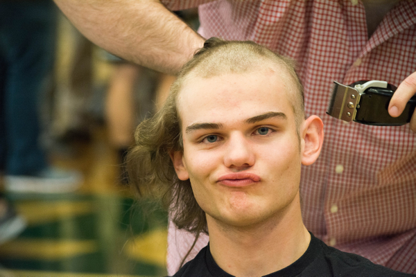 "The ""Save of Shave"" event at Hillcrest High School helped raise more than $1,300, the most they've ever made through the event; the money was donated to Make-a-Wish Foundation. Seen here is senior John Ruff, who had his hair shaved to support granting three people's wishes. (Melinda Schwendiman/Hillcrest High School Student Body Historian)"