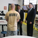 Massachusetts Department of Veterans' Services Secretary Francisco A. Ureña (center) and Middlesex Sheriff Peter J. Koutoujian (right) speak with an inmate in the MSO's Housing Unit for Military Veterans (HUMV)
