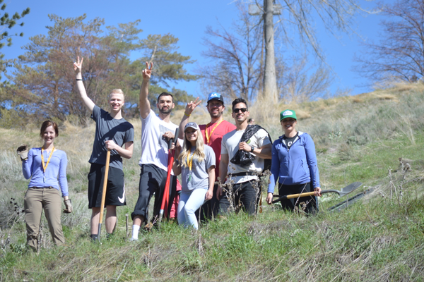 A group of volunteers having a great time at the Dimple Dell Earth Day Cleanup.