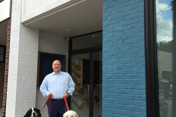 Brian Jeffe, mayor of Sewickley with Otis, a Bernese Mountain Dog, and Sophie, a Great Pyrenees.