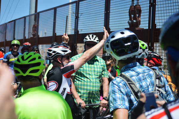 Riders from the north and south high-five after meeting up with one another. (Justin Adams | City Journals)