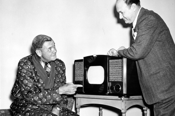 "Babe Ruth was able to see home games of the New York baseball teams, even while he was in his apartment, with this new television receiver presented to him by RCA Victor as a ""Babe Ruth Day"" gift. Irving Sarnoff, vice-president of Bruno-N.Y., RCA Victor distributors for the New York metropolitan area, made the presentation at Babe's Riverside Drive apartment. (Courtesy Hagley Museum & Library)"