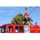 Unified Fire comes through the parade with its Rhinoceros. (Travis Barton/City Journals)