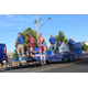 Riverton's elected officials toss candy to the crowd during the parade. (Travis Barton/City Journals)