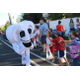 A tooth mascot from Talbot Orthodontics high-fives kids during the Riverton Town Days Parade. (Travis Barton/City Journals)