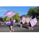 The Riverton High School marching band toss and twirl its way through the Riverton Town Days Parade. (Travis Barton/City Journals)
