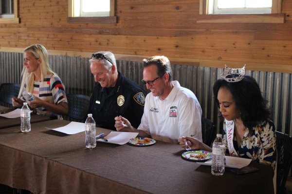 Judges such as Miss Draper Alexsys Campbell, Fire Chief Clint Smith and Police Chief John Eining participated in the homemade pie contest. (Travis Barton/City Journals)