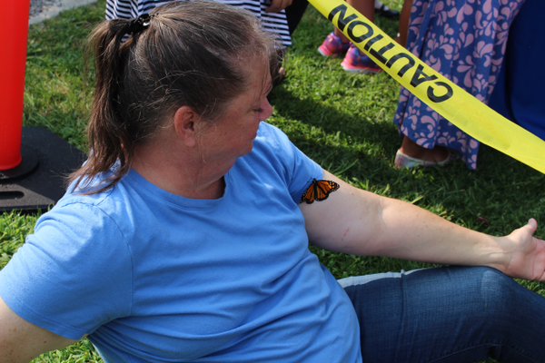 "One friendly butterfly nestles on the arm of Diane Bowler. It was her first time to the event and she said it was the ""perfect day for it."" It surprised her though. ""Never thought they'd land on you."""