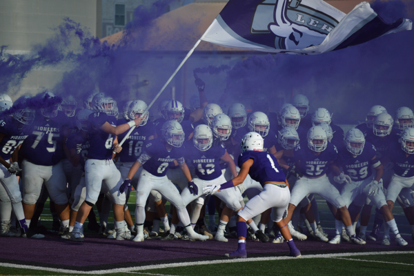 The Lehi football team pumps up their home crowd.
