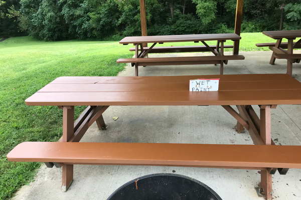 The benches were given a fresh coat of paint to complete the job.