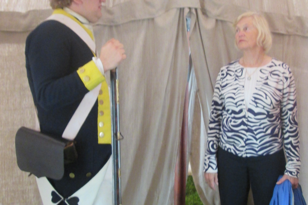 A reenactor discusses Washington's tent during the event.
