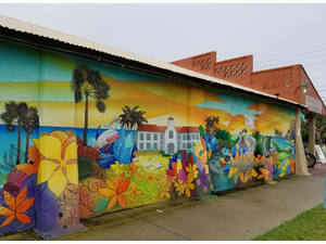 A colorful mural decorates Bensons grocery