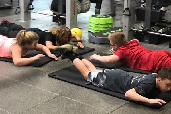 Kathy Hensler trains a couple of her clients at the Rose E. Schneider Family YMCA in Cranberry.