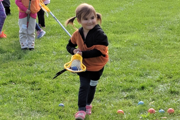 Savannah Archambeault is all smiles as she shows off her skills cradling the lacrosse ball in her stick. (Courtesy photo)