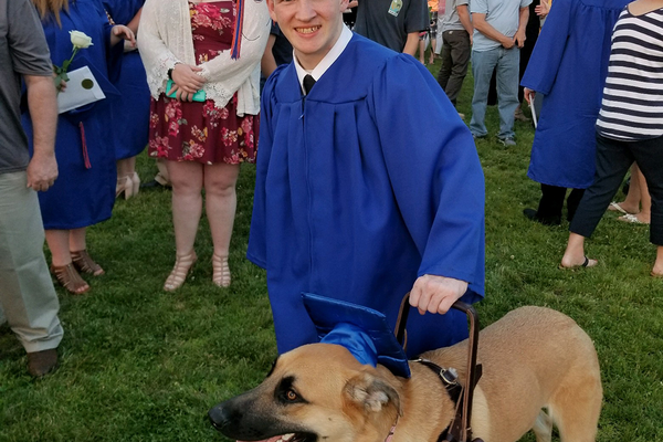 Logan McGinnis and his service dog, Reese. Photo courtesy of Canine Service Pals