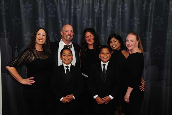 Tiffany Bevan, Tim Purkis, Krishelle Tanner, Elanie Purkis, and Amy Singh with Ryan and Matthew Purkis