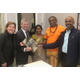 At the real estate closing LR are Nicole Shannon the property sellers attorney Christopher Nichols the Temples attorney Mrs Mangalam Sambamoorthy Temple President Sivachariar Bhairavasundaram Muthubattar Temple priest and congregation member Muthu Meyyappan